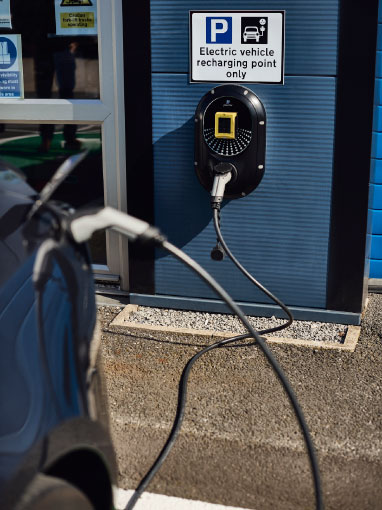 electric car linked to car charger